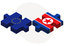 European Union and Korea-North Flags in puzzle Stock Photos
