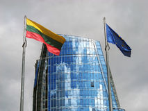 European Union and Lithuania. Flags in Vilnius nearby new skyscraper Royalty Free Stock Images