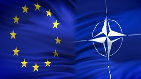 European Union and NATO flags background, diplomatic and economic relations stock image