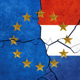 European union and Netherlands flags. Breaking apart Stock Images