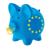 European union piggy bank. Blue piggy bank with european union stars on it and with an euro symbol in its nose Stock Image