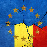 European union and Romanian flags. Breaking apart Royalty Free Stock Images
