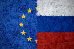 European Union and Russian flags. On the concrete texture Royalty Free Stock Images