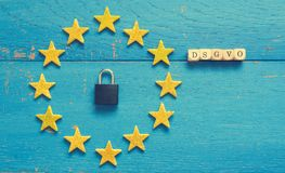 European Union sing with padlock. European Union sign with a padlock on a blue rustic wooden background, DSGVO concept image Royalty Free Stock Photos