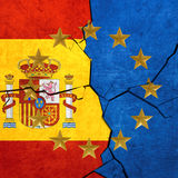 European union and Spanish flags. Breaking apart Royalty Free Stock Photo