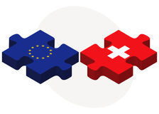 European Union and Switzerland Flags in puzzle isolated on white background Royalty Free Stock Image