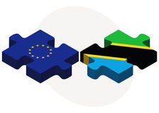 European Union and Tanzania Flags in puzzle isolated on white background Royalty Free Stock Photos