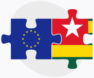 European Union and Togo Flags in puzzle isolated on white background Stock Images