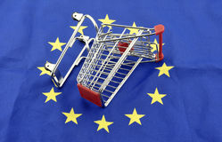 European Union trade market surplus deficit shopping cart isolated september 18, 2016. European Union trade market surplus deficit shopping cart isolated stock photography