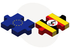 European Union and Uganda Flags in puzzle isolated on white background Royalty Free Stock Photos