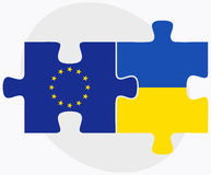 European Union and Ukraine Flags in puzzle isolated on white background Royalty Free Stock Photos