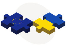 European Union and Ukraine Flags in puzzle isolated on white background Royalty Free Stock Photo