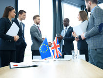 European Union and United Kingdom leaders shaking hands on a deal agreement. Stock Photos