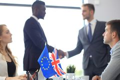 European Union and United Kingdom leaders shaking hands on a deal agreement. Brexit. European Union and United Kingdom leaders shaking hands on a deal agreement royalty free stock image