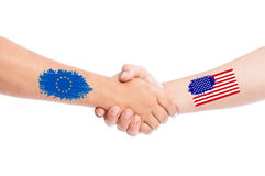 European Union and USA hands shaking with flags Royalty Free Stock Photos
