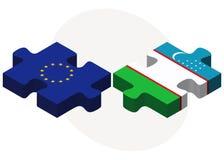 European Union and Uzbekistan Flags in puzzle isolated on white background Stock Photo