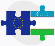European Union and Uzbekistan Flags in puzzle isolated on white background Royalty Free Stock Photo