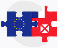 European Union and Wallis and Futuna Flags in puzzle isolated on white background Royalty Free Stock Photos