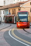 European urban red train rides on the urban rail in Italy, day,. Daylight, front view, vertical shot, space for text Royalty Free Stock Photos