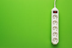 European 5-way power strip. Earthed on green background Royalty Free Stock Image