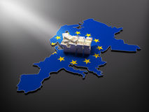 European wealth. Europe map, with European flag and a pile of stacked money representing European wealth and prosperity Royalty Free Stock Image