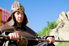 European wearing Mongolian armour. European man in ancient Mongolian soldier armour royalty free stock photography
