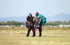 European white male walking and talking with black African skydi. RUSTENBURG, SOUTH AFRICA - April 28, 2017: National Skydiving Championships. European white Royalty Free Stock Photos