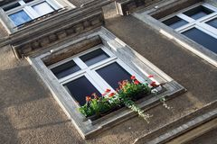European Window with Red Flowers. A typical German window with a flower box filled with red flowers Stock Image