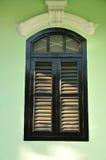 European windows on the green wall Stock Image