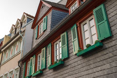 European windows with green wooden shutters in old house. Outdoo Stock Photos