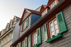 European windows with green wooden shutters in old house. Outdoo Royalty Free Stock Images
