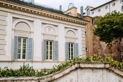 European windows with wooden shutters. Old house exterior. Rome, Italy Stock Photo