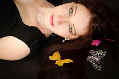 European woman with butterflies on the hair Royalty Free Stock Photography