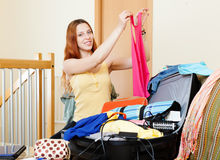 European woman choosing clothes for vacation Royalty Free Stock Image