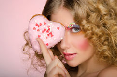 European woman with donut in face Stock Photo
