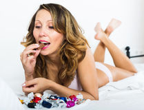 European woman eating chocolate candy Stock Photo