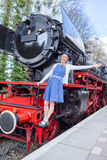 European woman expressing happiness for freedom and peace on steam train royalty free stock images