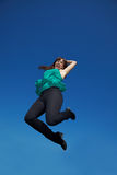 European woman jumping high Royalty Free Stock Photography
