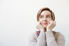 European woman pensively looks to the side. Stock Photos