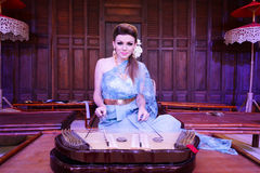 European Woman Playing Thai Musical Instrument Dulcimer Stock Image
