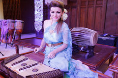 European Woman Playing Thai Musical Instrument Dulcimer Royalty Free Stock Photos