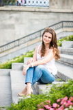 European woman sitting on steps Royalty Free Stock Photo