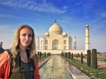 European woman the tourist against Taj Mahal stock image