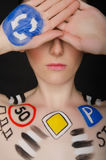 European woman with traffic signs on her body Stock Photography