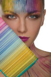 European women with colorful purse and face art Stock Photo