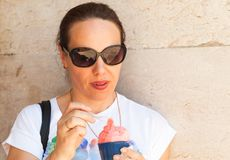 European young adult woman eats ice cream Royalty Free Stock Images