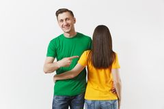 European young brunette woman, smiling man showing thumbs up, football fans in yellow green empty t-shirt isolated on. European young brunette woman, smiling men royalty free stock photo