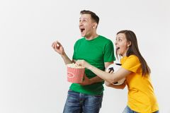 European young couple, woman, man, football fans in yellow green t-shirt cheer up support team with soccer ball bucket. Of popcorn isolated on white background royalty free stock image