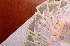 Europees geld, Oekraïense hryvnia Stock Afbeelding
