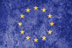Europeisk facklig flagga på bakgrund för grungestentextur Royaltyfri Bild
